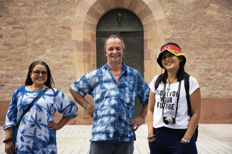 German old man and thai woman people travel and visit Speyer town. German old man and thai woman people travel and visit Speyer cathedral at Speyer town on royalty free stock images