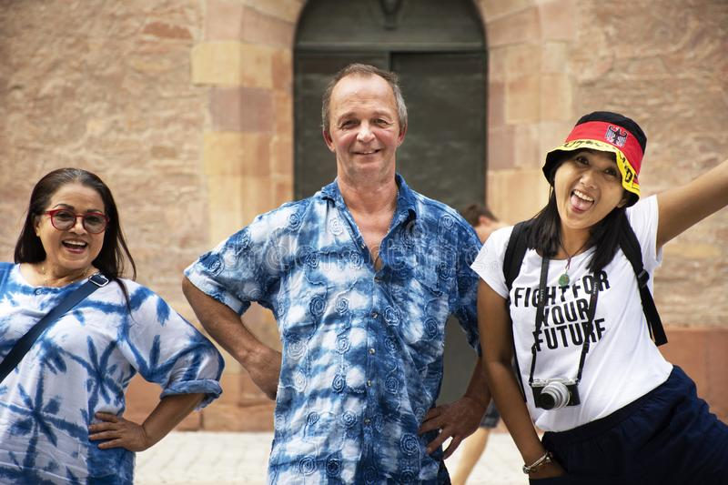 German old man and thai woman people travel and visit Speyer town. German old man and thai woman people travel and visit Speyer cathedral at Speyer town on royalty free stock photography