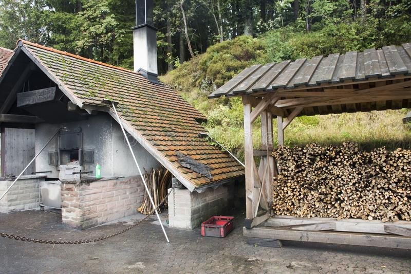 German old men use firewood stove old style cooking bread at restaurant. Near Mummelsee lake in Black Forest or Schwarzwald on September 9, 2017 in Stuttgart stock photos