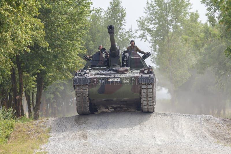 German Panzerhaubitze 2000, artillery tank drives on a road. FELDKIRCHEN / GERMANY - JUNE 9, 2018: German Panzerhaubitze 2000, artillery tank drives on a road on royalty free stock photography
