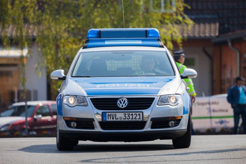 German police car drives on a street. ALTENTREPTOW / GERMANY - MAY 1, 2016: german police car drives on a street in altentreptow, germany at may 1, 2016 stock photos