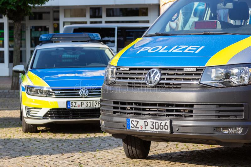 German police cars stands on a public event. PEINE / GERMANY - JUNE 22, 2019: German police cars stands on a public event, day of the uniform in Peine. Polizei royalty free stock photo