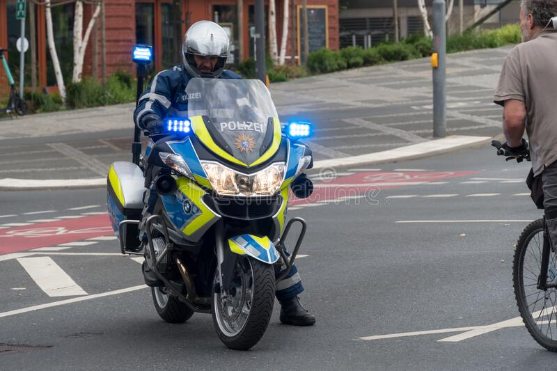 German police officer on motorcycle stock photos