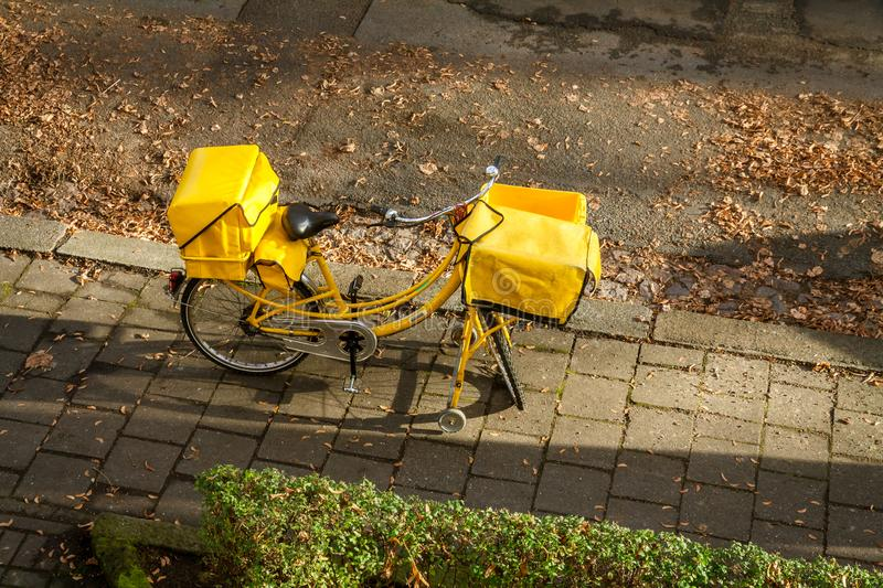 German Post woman. With bicycle stock photography