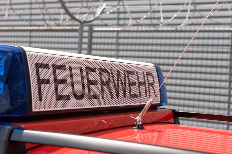 German red fire brigade car. With blue light stock image