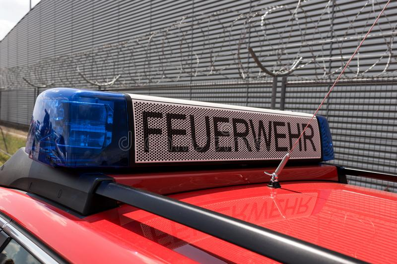 German red fire brigade car. With blue light stock photography