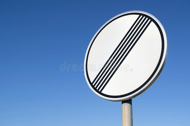 End of previous limitation. German road sign: end of previous limitation stock photo