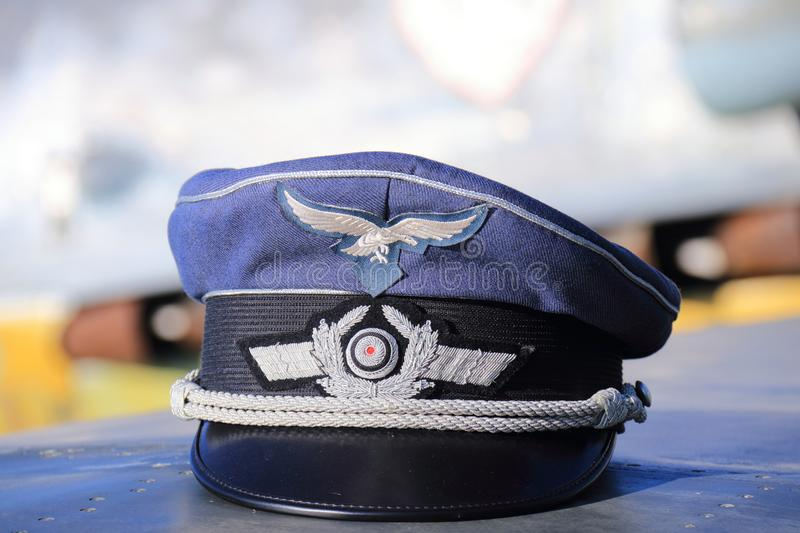 German second world war II fighter pilot hat. German pilot hat on a wing of a messerschmitt bf 109 fighter plane. Displayed at the wings of freedom event near stock photos