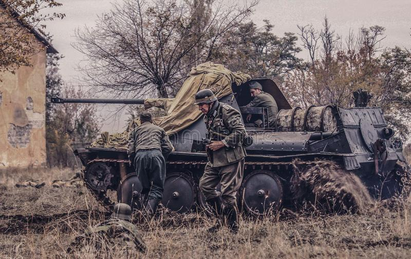 German self-propelled artillery and soldiers royalty free stock photo