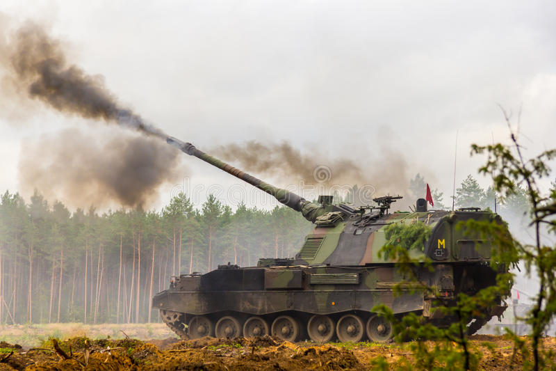 German self-propelled howitzer on battlefield. A german self-propelled howitzer on battlefield royalty free stock images