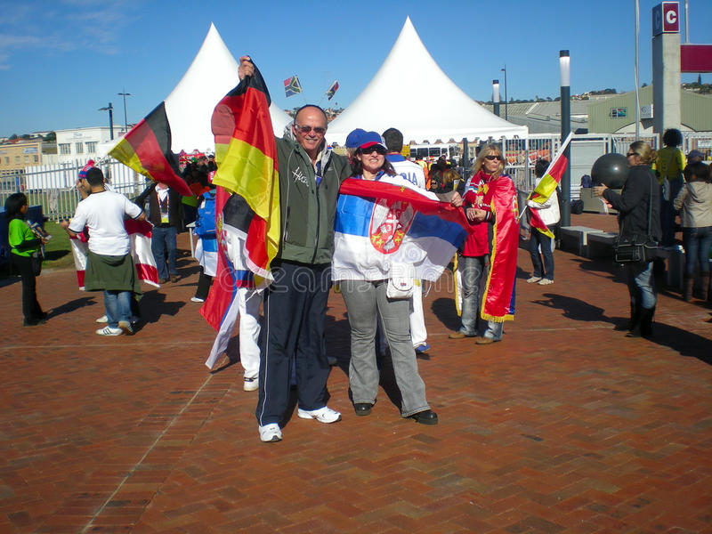 German and Serbian soccer fans stock image