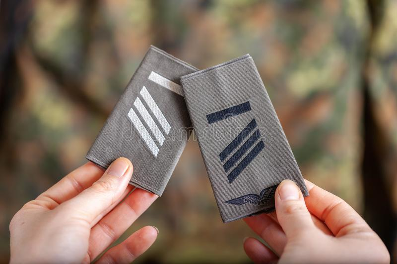 German shoulder ranks on a camouflage background. Shoulder ranks on a camouflage background stock photos