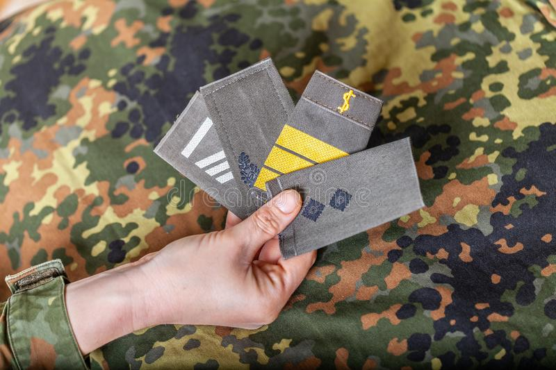 German shoulder ranks on a camouflage background. Shoulder ranks on a camouflage background royalty free stock images