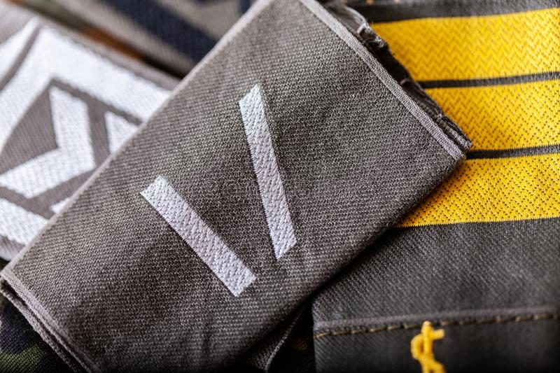 German shoulder ranks on a camouflage background. Shoulder ranks on a camouflage background royalty free stock image