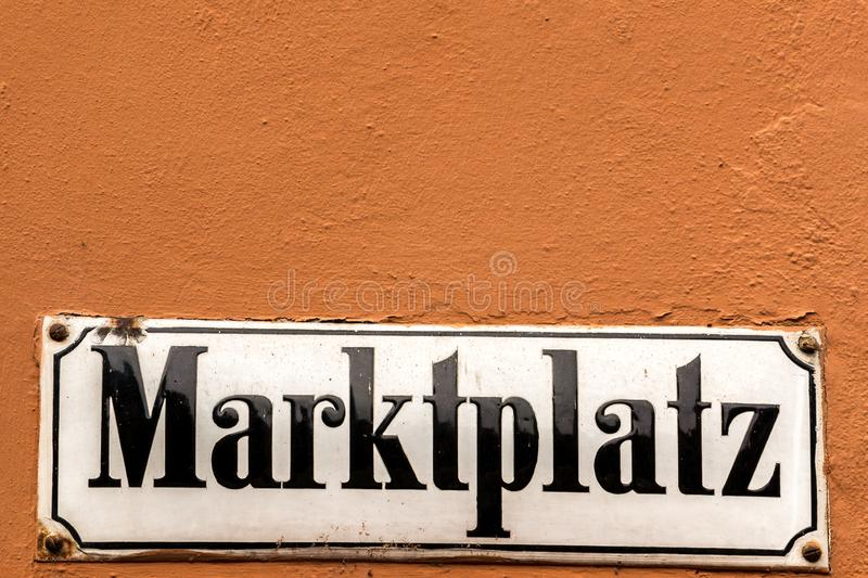 German sign for marketplace on the outer wall stock images