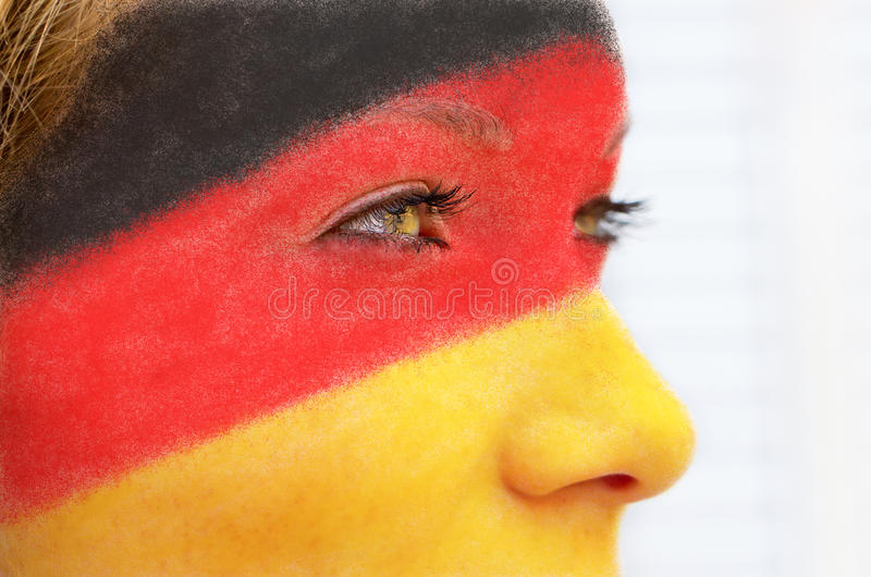 German soccer fan. Girl with german colors in her face stock photography