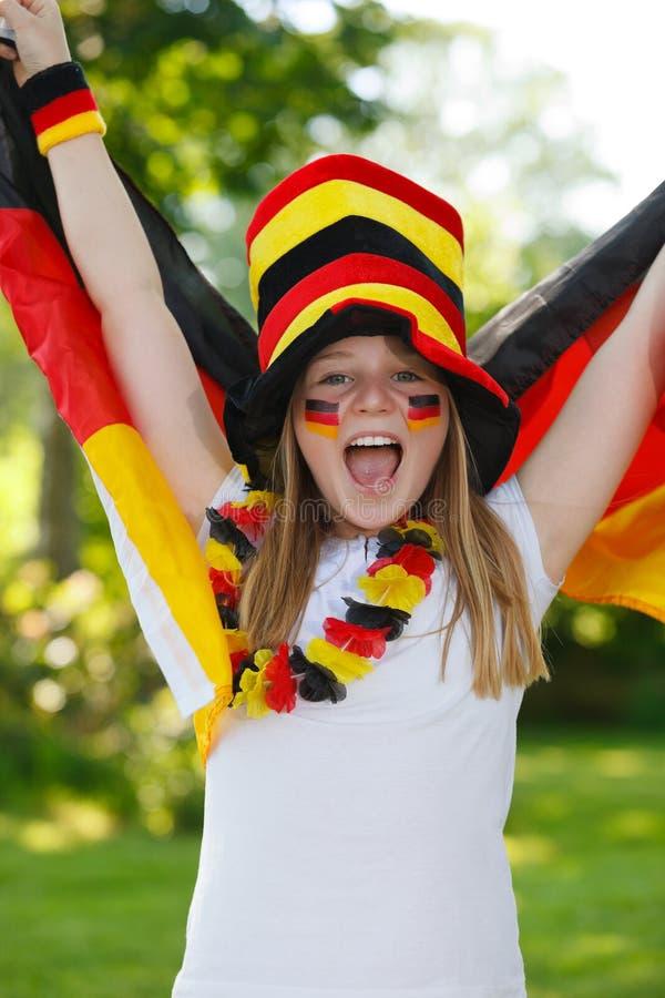 German soccer fan waving her flag. German soccer fan waving a flag outdoor stock images