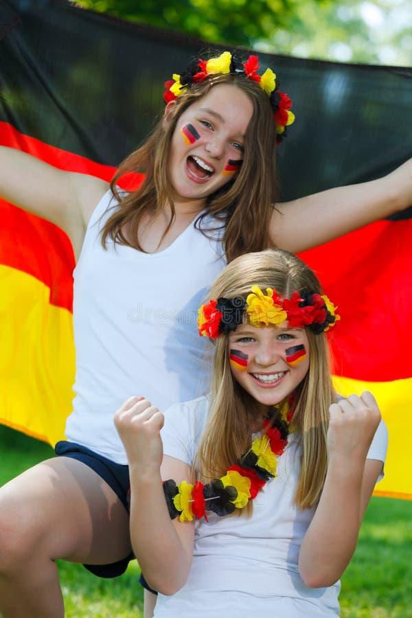 German soccer fans outdoor. German soccer fans cheering outdoor stock image