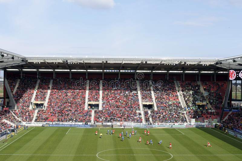 German soccer league match Mainz against Wolfsburg. Mainz, Germany - March 22, 2015: The German Soccer League match FSV Mainz 05 against VFL Wolfsburg in the Co stock photo