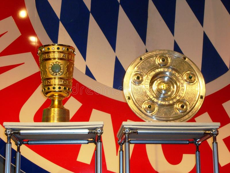 German soccer trophies and Bayern Munich Logo. Bayern Munich Logo and the two most important German soccer trophies at press conference royalty free stock images