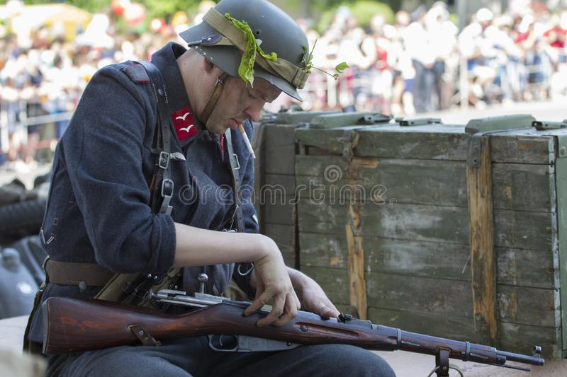.German soldier of the second world charges weapons royalty free stock image