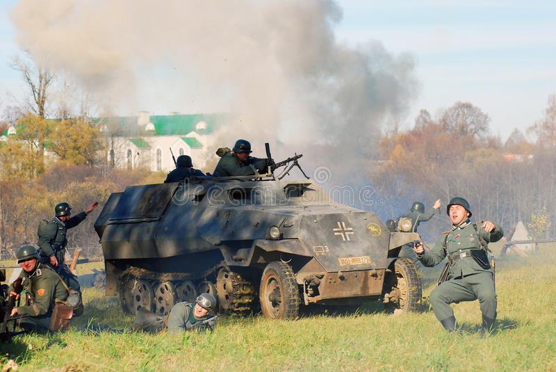 German soldiers-reenactors fight by the tank stock photography