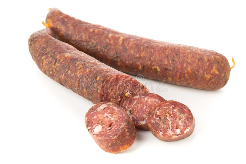 German specialty salami hard cured sausage whole and sliced over stock images