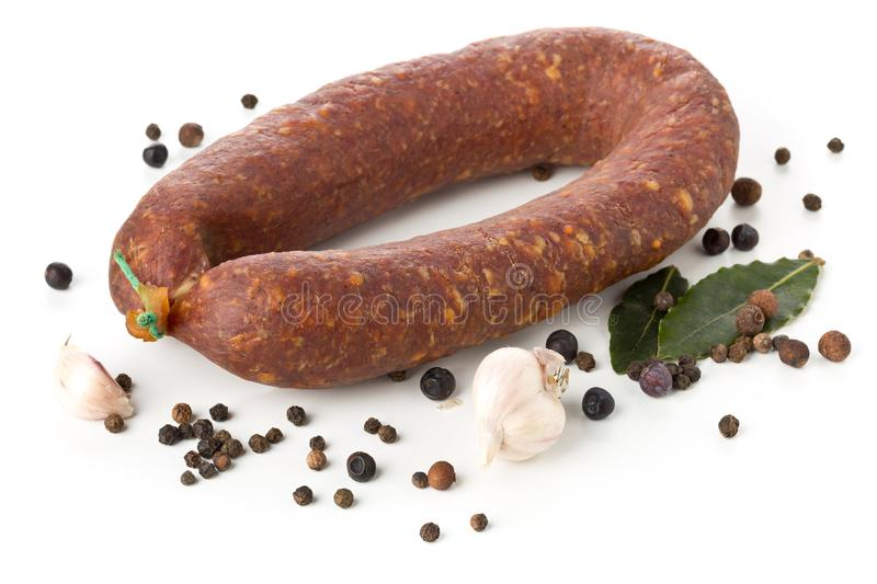 German specialty salami hard cured sausage whole with spices over white royalty free stock photography