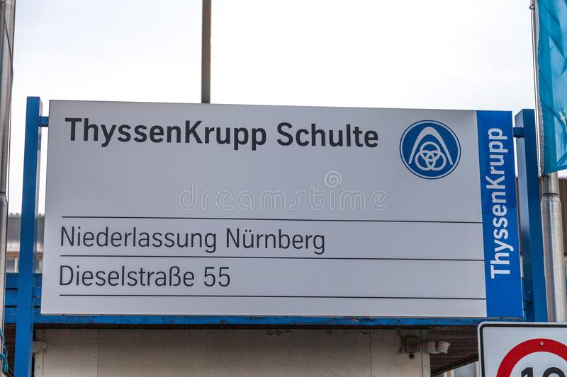 German steel producer ThyssenKrupp logo on entrance building. NUERNBERG / GERMANY - MARCH 4, 2018: German steel producer ThyssenKrupp logo on entrance building stock photography