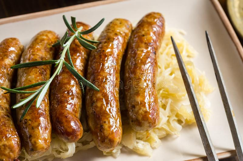 Traditional Grilled Sausages with Cabbage Salad, Mustard and Beer stock photo