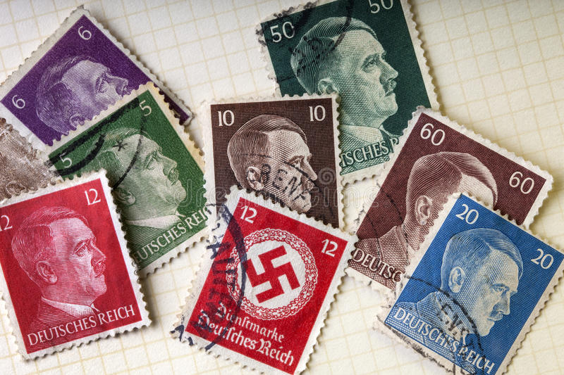 German War Stamps - Adolph Hitler - Swastika. German Third Reich postage stamps of the second world war with Adolph Hitler and the Nazi Swastika royalty free stock photo