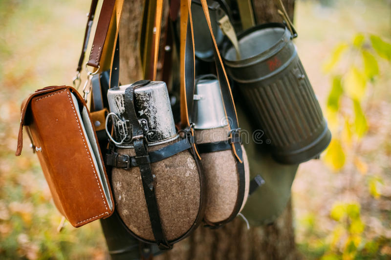 German Wehrmacht Infantry Soldier`s Military Equipment Of World. War II. Flasks And Bag Tank For Anti-gas Hanging In Tree Trunk royalty free stock photos