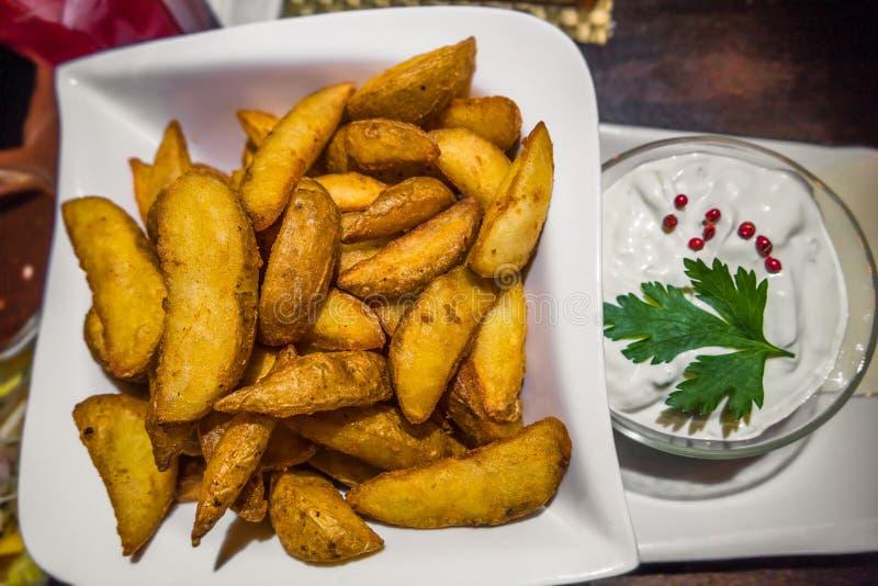 German western potatoes and garlic sour cream sauce stock photography