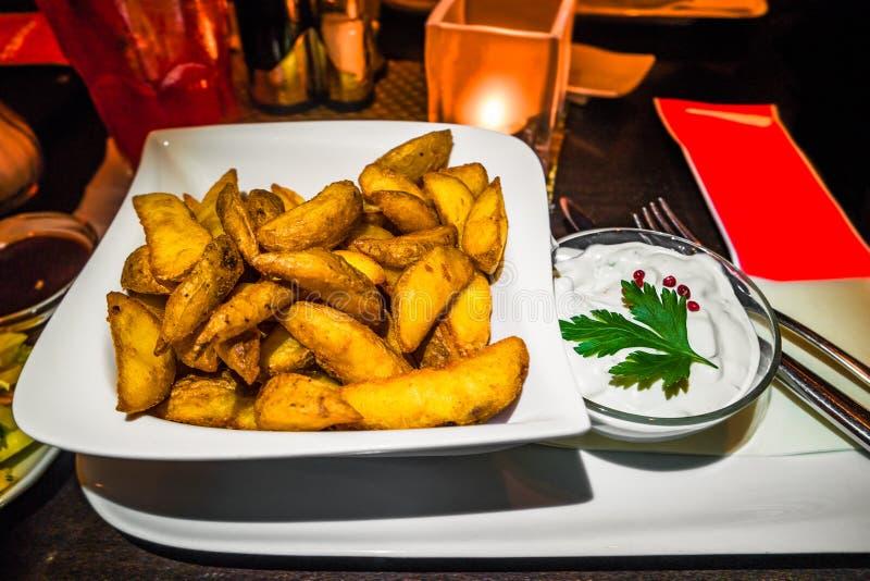 German western potatoes and garlic sour cream sauce royalty free stock photos
