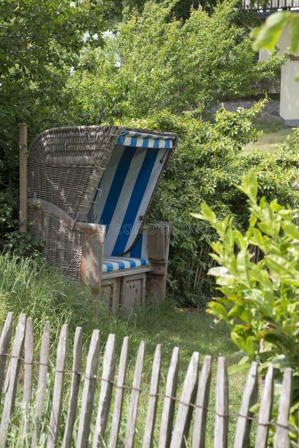 German Wicker Beach Chair In A Garden royalty free stock photo