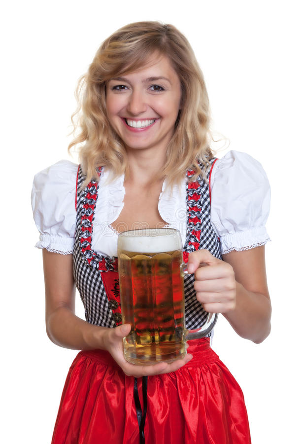 German woman in a traditional bavarian dirndl with beer glass. On an isolated white background for cut out royalty free stock images