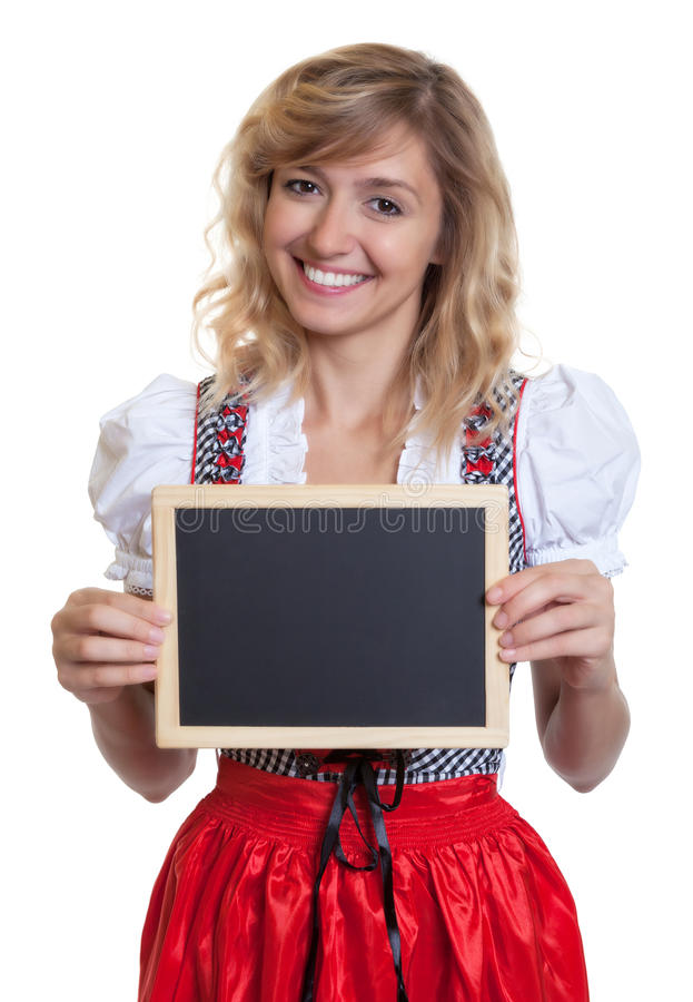 German woman in a traditional bavarian dirndl with chalk board. On an isolated white background for cut out royalty free stock image