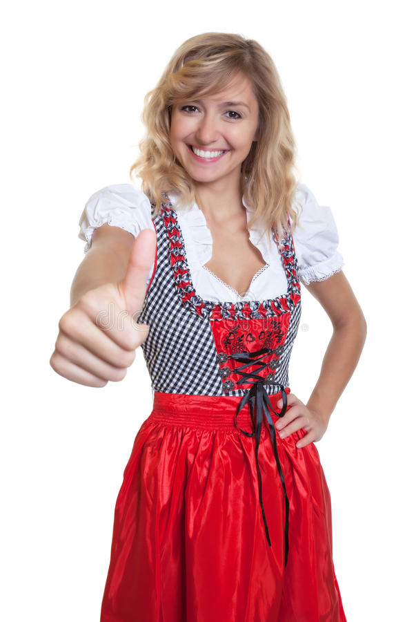 German woman in a traditional bavarian dirndl showing thumb up. On an isolated white background for cut out stock photo