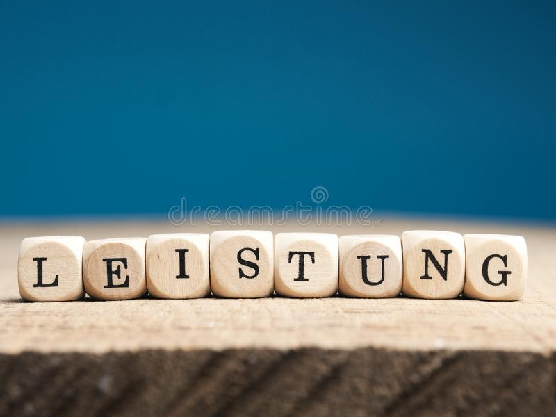 German word effort on wooden dices stock images