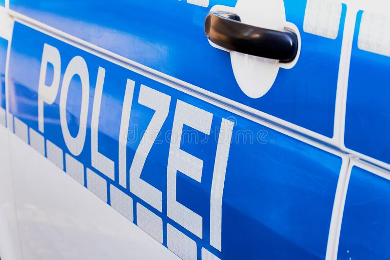 German word Polizei on a German police car stock photo