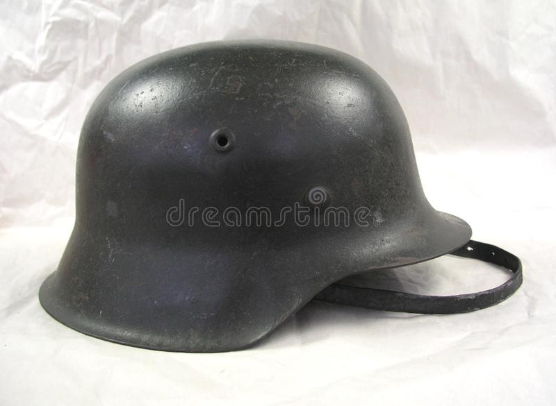 German World War 2 WWII Military Helmet with chin strap. German World War 2 WWII Military Soldier Helmet with chin strap stock photo