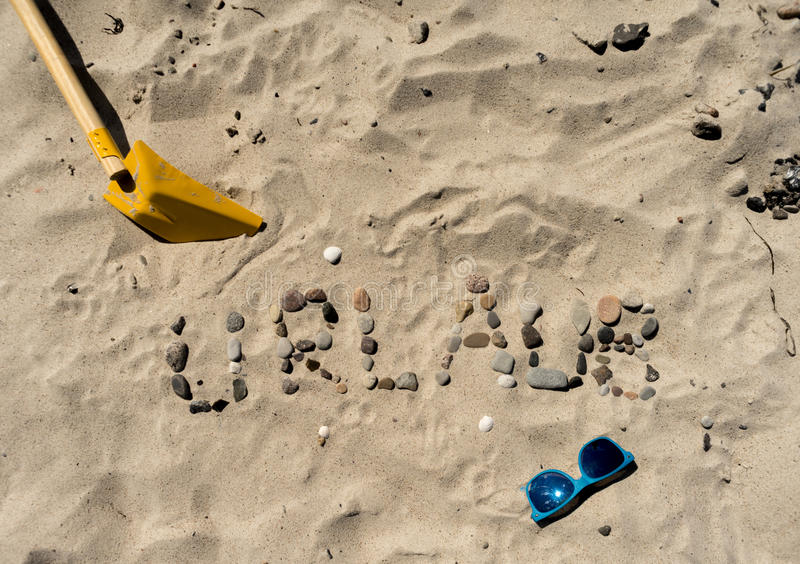 German writing Urlaub in the sand royalty free stock images