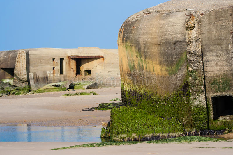 German wwii bunkers. Atlantic Wall bunkers on the Wissant beach, Nord-Pas-de-Calais – France royalty free stock image