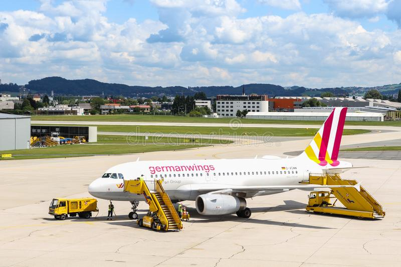 Germanwings aircraft Airbus A319-100 after arrival in the Salzburg airport and ground service personnel. SALZBURG, AUSTRIA - JUL 16 2017: Germanwings aircraft stock photo