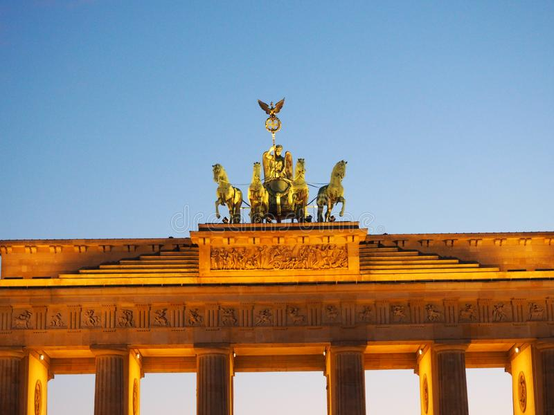 Germany, Berlin, The Brandenburg Gate The Quadriga on top of the gate featuring a chariot drawn by four horses driven b royalty free stock photos