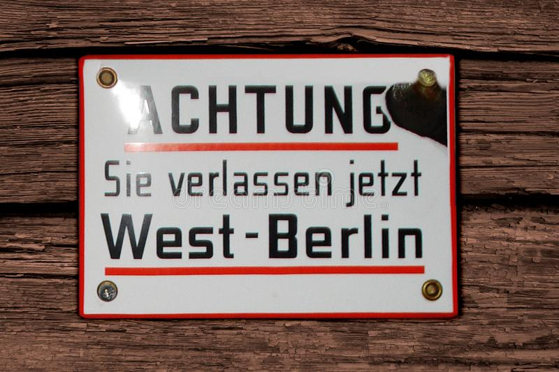 Germany, Bremen, Nov. 2007 – Warning sign plate Attention You are leaving now West Berlin in German language. Historical object stock photo