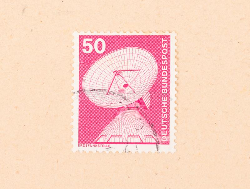 GERMANY - CIRCA 1980: A stamp printed in Germany shows a communication dish, circa 1980 stock photography