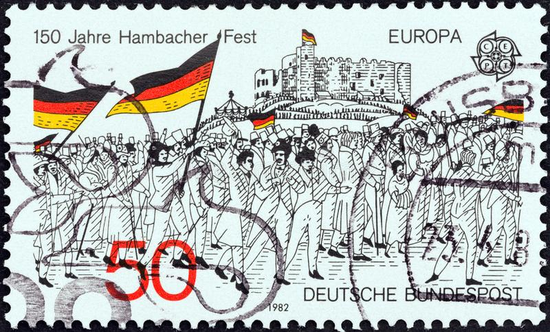 GERMANY - CIRCA 1982: A stamp printed in Germany shows the rally to Hambach Castle, 1832 wood engraving, circa 1982. GERMANY - CIRCA 1982: A stamp printed in royalty free stock image