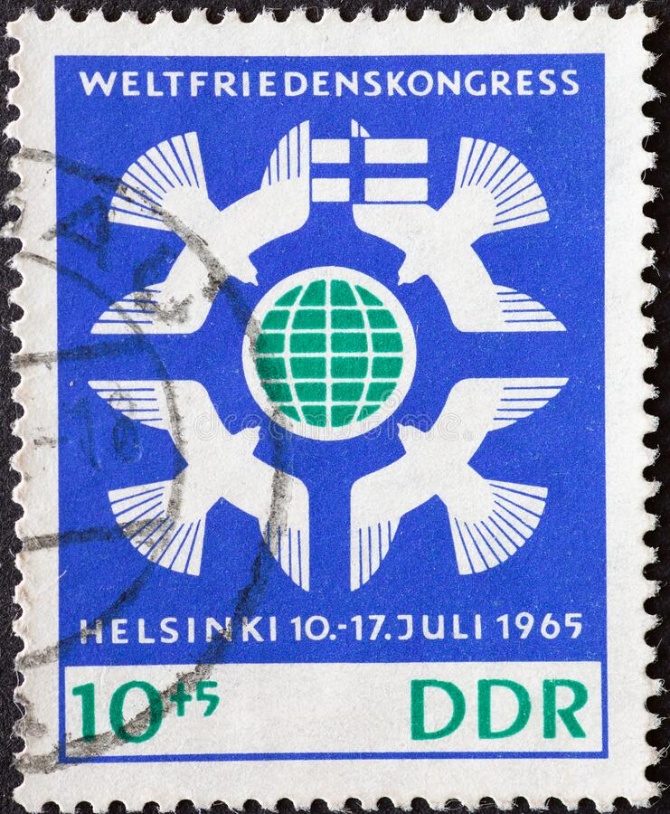 Free GERMANY, DDR - CIRCA 1965  : A Postage Stamp From Germany, GDR Showing Some Peace Doves Around Earth Globe, Flag Of Finland. World Royalty Free Stock Photography - 214615167