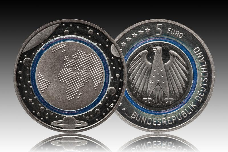 Germany five euro coin with planets and blue polymer ring. Proof royalty free stock photos